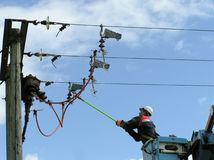 Power lineman. Closing switch on high voltage line stock image