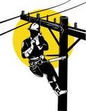 Power lineman on a pole Stock Photos