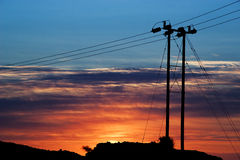 Power Lines -01. Power Lines Against A Colorful Sky Royalty Free Stock Photos