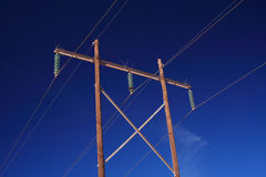 Power lines. Sustained by two wooden poles Royalty Free Stock Photos