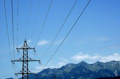 Power lines. With mountains on the background Royalty Free Stock Photography