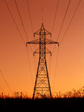 Power Lines. High tension power line tower at sunset Royalty Free Stock Photography