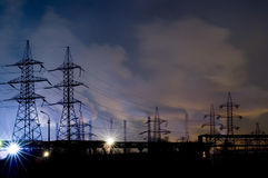Power lines. At Metallurgical plant at the night Stock Image