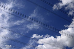 Power lines. On a blue sky Stock Photography
