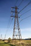 Power lines. Power pole or electricity pylon and cables Stock Image