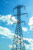 Power Lines. On a sunny day against blue sky with clouds Stock Photography