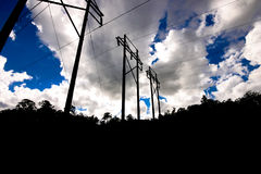 Power lines. High voltage power lines in Florida with cloudy sky overhead Royalty Free Stock Images