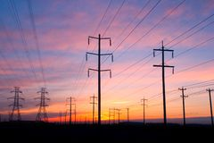 Power Lines. Various powerlines against a colorful sunset royalty free stock photos