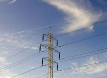 Power lines. On the background of a blue sky royalty free stock photos