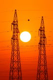 Power lines. Sun behind 2 electrical power cables Stock Photography