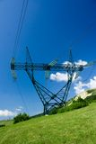 Power lines. Towers over blue sky Royalty Free Stock Image