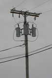 Power Lines. Isolated in an overcast sky Stock Photo