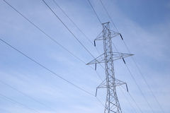 Power lines. On a blue sky Royalty Free Stock Image