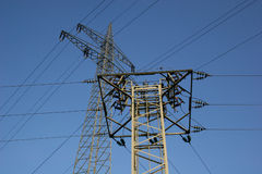 Power lines across. In front of blue sky stock photo