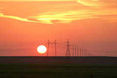 Power lines against the background of a beautiful sunset Stock Images