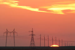 Power lines against the background of a beautiful sunset Royalty Free Stock Photos