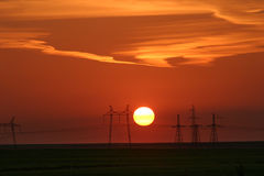 Power lines against the background of a beautiful sunset Stock Photo