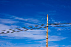 Power Lines against a Beautiful Sky. Power lines and post against a beautiful cloudy blue sky. NOTE: RAW format available for download royalty free stock images