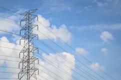 Power lines against the blue sky Stock Photos