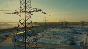 Power lines and along the highway at dawn, view from above