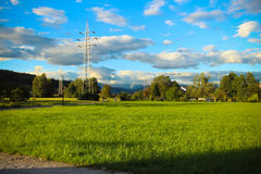 Power lines. Power lines on the background of beautiful cloudy sky and mountains Royalty Free Stock Photos