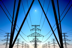 Power lines on blue sky. Royalty Free Stock Image