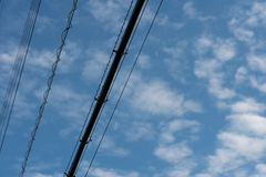 Power Lines on Blue Sky Royalty Free Stock Image