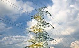 Power lines on a blue sky. Electrical power line tower agaist blue sky Stock Photography
