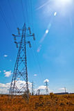 Power lines, blue sky and sun light Stock Photo