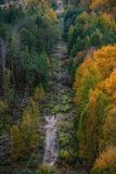 Power lines in the Chernobyl exclusion zone. Pass through the bright autumn forest stock photography