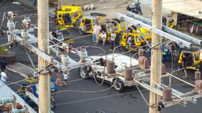 Power lines in the city. Transformers and phone lines against road in Filipino city. Power lines in the city. Transformers and phone lines against road in Stock Photography