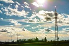 Power lines at cloud iridescent sky Stock Photos