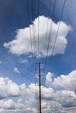 Power lines and clouds in sky. Stock Images