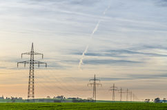 Power lines with cloudy sky Stock Photography