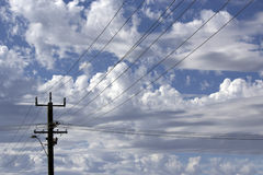 Power lines in Cloudy  Urban Skyscape Royalty Free Stock Photography