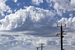 Power lines in Cloudy  Urban Skyscape Stock Images