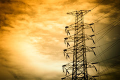 Power lines on a colorful sunrise. Electric power lines against sky at sunrise Stock Photos