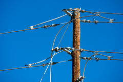 Power lines and connections on a wooden post Royalty Free Stock Image