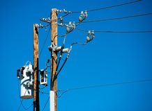 Power lines and connections on a wooden post Stock Images