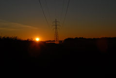 Power lines at dawn Royalty Free Stock Photo