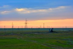 Power lines and derrick in twilight, the colorful sky Stock Photo
