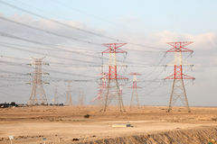 Power lines in the desert of Qatar Royalty Free Stock Image