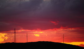 Power lines with dramatic sunset Royalty Free Stock Photo