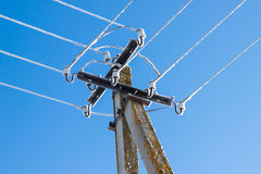 Power lines dripping with icicles against blue sky Stock Photography