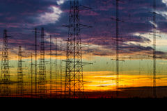 Power lines in the dusk. High voltage power lines in the dusk Royalty Free Stock Photo