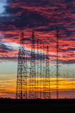 Power lines in the dusk. High voltage power lines and pylars silhouettes in the dusk Royalty Free Stock Image