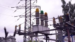 Power lines and electric poles. Frame. High-voltage lines against background of electrical distribution stations.  stock footage