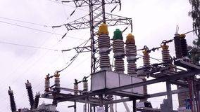 Power lines and electric poles. Frame. High-voltage lines against background of electrical distribution stations.  stock video