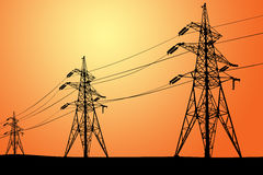 Power lines and electric pylons. Black silhouette of Power lines and electric pylons on a red Stock Photography