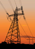 Power lines and electric pylons. Vector silhouette of Power lines and electric pylons. Sunset in background Stock Photo